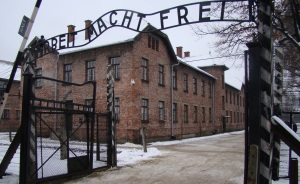The famous Arbeit Macht Frei gate with the brothel building in the background