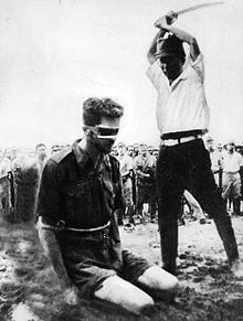 An Australian POW is beheaded by Japanese