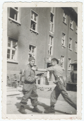 "Two Buchenwald survivors ""play fighting"""