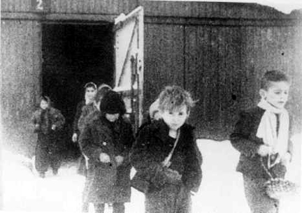 Child survivors leaving the barracks at Birkenau after the camp was liberated