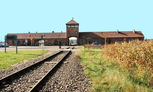 Train tracks go through the Birkenau gate house