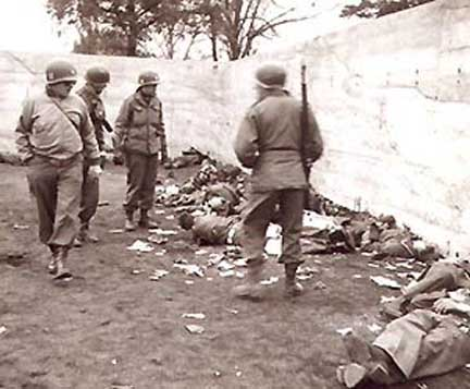 American soldiers inspect bodies in the coal yard
