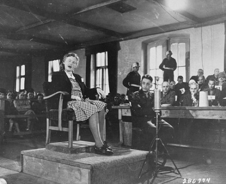 Ilse Koch testifies on the witness stand at Dachau