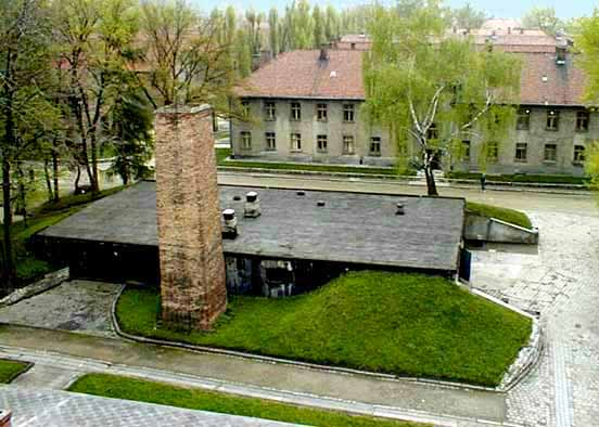 Auschwitz gas chamber in the foreground with SS hospital in the background