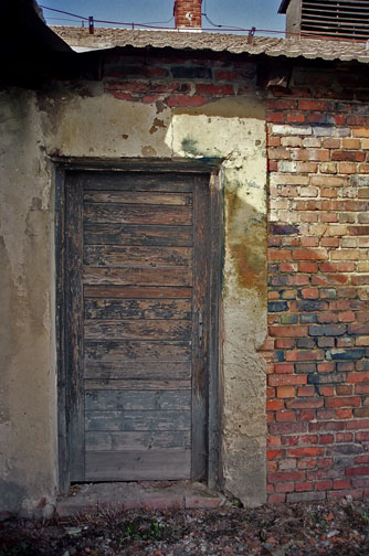 Door into Gaskammer building has blue stains caused by use of Zyklon-B
