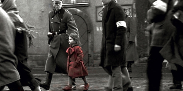 What is the meaning of the girl in the red coat in schindler s list