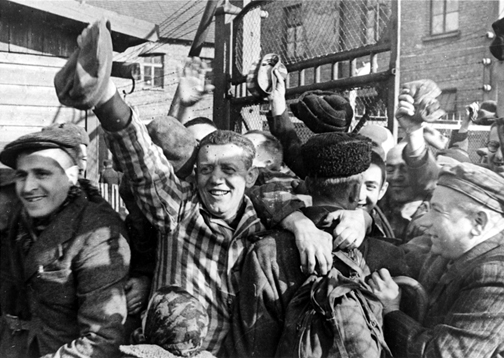 Survivors in the main Auschwitz camp re-enact the liberation for a documentary made in Feb. 1945