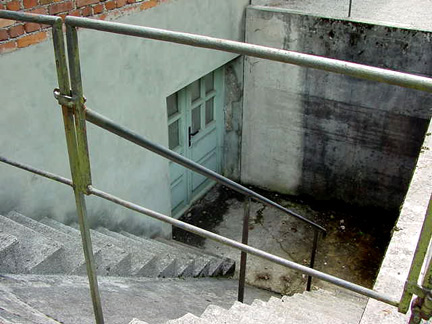 Stairs leading down to the basement of Baracke X at Dachau