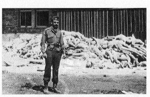 Captain Alfred de Grazia stands in front of Dachau crematorium, May 1, 1945