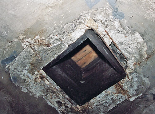 One of the four vent holes in the ceiling of the Auschwitz gas chamber