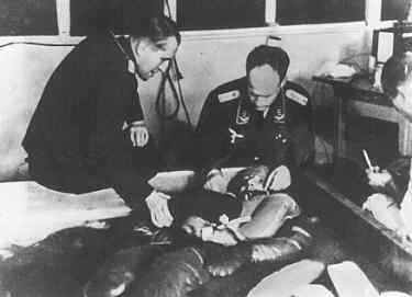 Dr. Sigmund Rascher is shown on the right, as he conducts an experiment