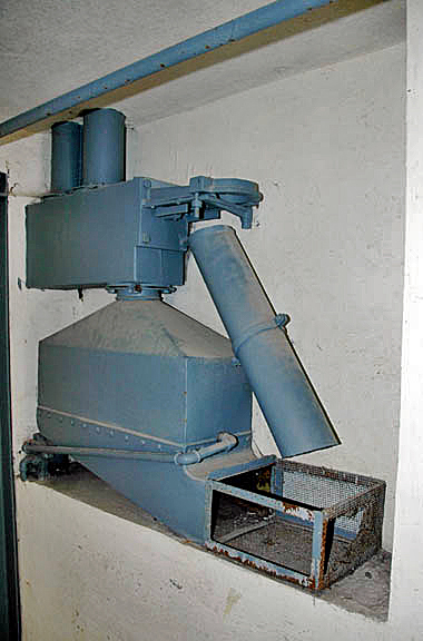 Degesch machine used to open a can of Zyklon-B and pour the pellets into a basket