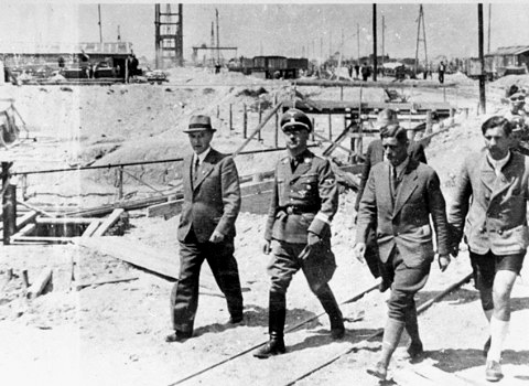 Heinrich Himmler on a visit to the Monowitz camp, with German engineers
