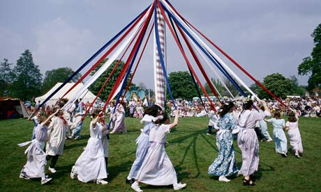 Young girls dancing around a Maypole