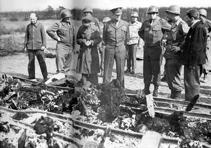 General Eisenhower views the railroad tracks where bodies were burned at Ohrdruf