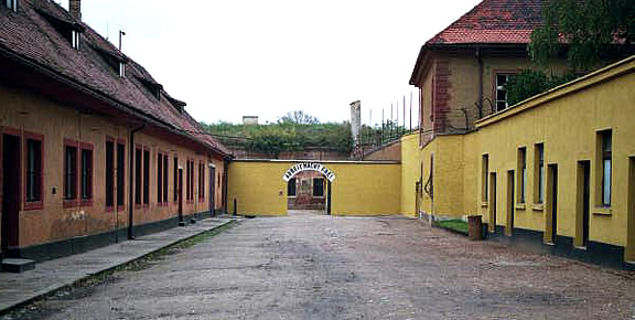 The Administration Courtyard with the Arbeit Macht Frei sign at the end
