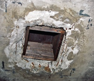 One of the four reconstructed holes in the ceiling of the Auschwitz gas chamber