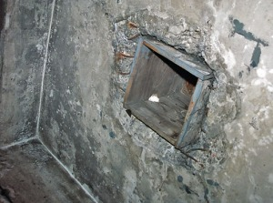 Reconstructed hole in the ceiling of the Auschwitz gas chamber