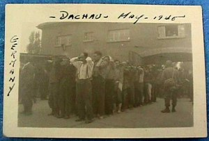 German prisoners line up outside the gate into War Crimes Enclosure No. I in the Dachau camp