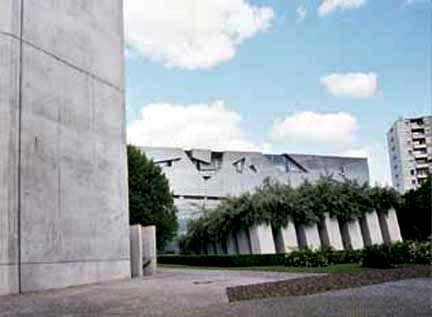 Garden outside Jewish Museum has stone columns planted with trees