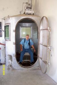 A man sitting inside a real gas chamber
