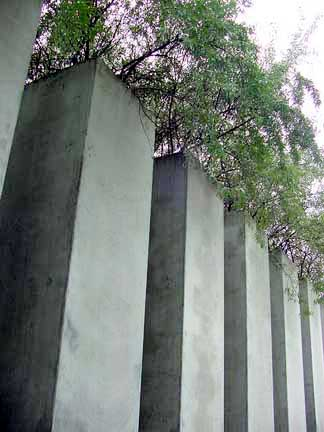 Trees growing out of columns in the garden outside the Jewish Museum