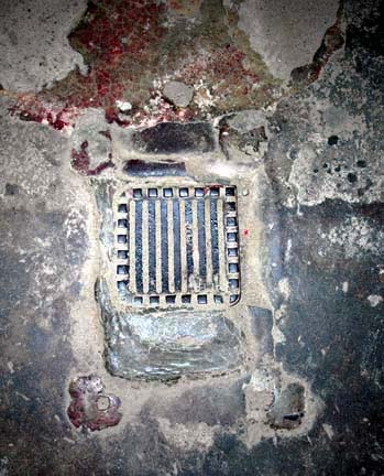 Vent hole in the ceiling of the Auschwitz gas chamber