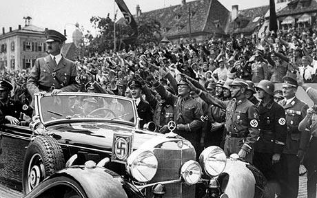 Hitler rode though the streets in a Mercedes as crowds cheered