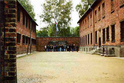 The Wall of Death is at the end of a courtyard between Block 10 and Block 11 at Auschwitz