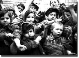 Children who survived the Auschwitz death camp show their tattoos