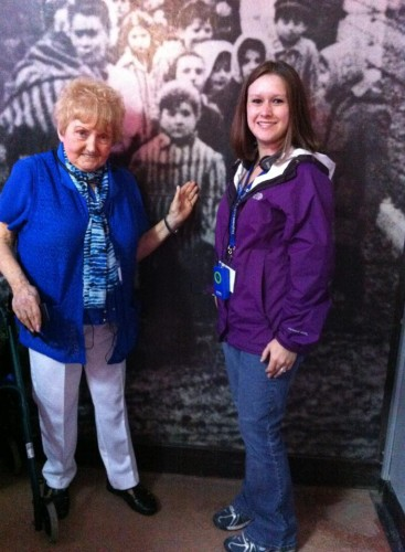 Eva Mozes Kor points to a photo of her marching out of the Auschwitz-Birkenau camp in 1945