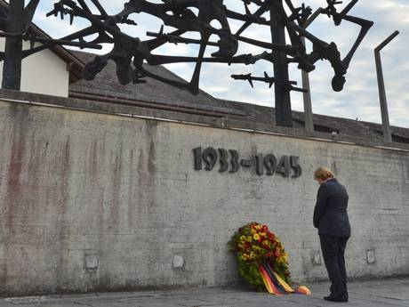 Angela Merkel lays a wreath at the International Monument at Dachau
