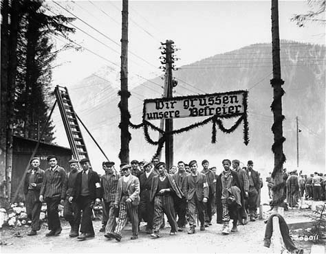 Healthy German prisoners at Ebensee march out of the camp after it was liberated