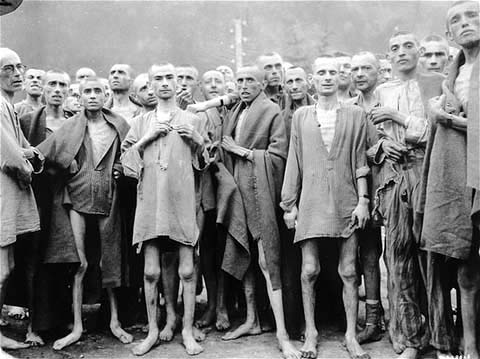 Ebensee survivors have shaved heads to prevent the spread of lice