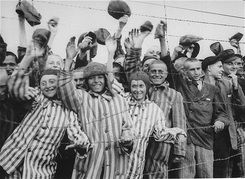 Steve Ross is the young boy on the far left, standing at the barbed wire fence around Dachau