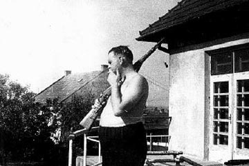 Amon Goeth standing on the patio of his home, near the Plaszow camp