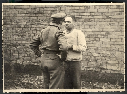 Mass-murderer Rudolf Hoess appears to be afraid of the nice British soldier