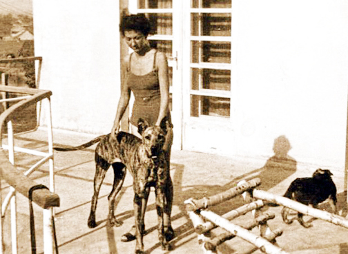 Ruth Irene Kalder, the mother of Monkia Goeth, standing on the balcony of Amon Goeth's home
