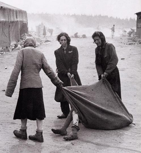 Jewish prisoners dragging a dead body at Bergen-Belsen