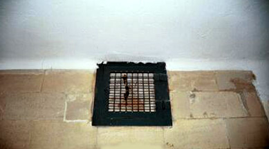 "Close-up of ""gas vent"" on the wall of the Dachau gas chamber"