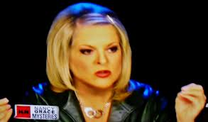 Nancy Grace wearing handcuff necklace