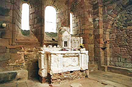 The altar inside the Oradour-sur-Glane church had 3 windows behind it