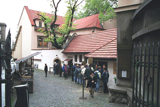 Tourists line up to enter the Pinkas Synagogue in Prague