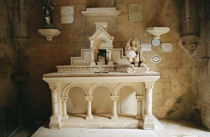 Side altar in Oradour-sur-Glane church as no smoke or fire damage