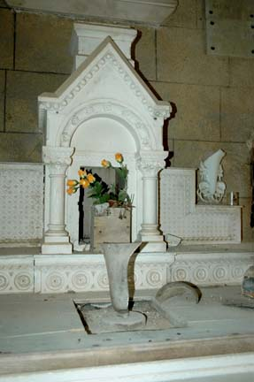 Close-up of side altar in Oradour-sur-Glane church has no smoke or fire damage