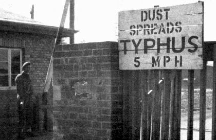 Sign on the gate at Bergen-Belsen warns that there is a typhus epidemic