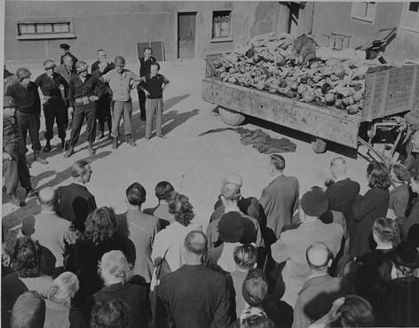 German citizens forced to look at a pile of corpses on April 16, 1945