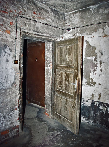 Door in the Auschwitz gas chamber opens inward