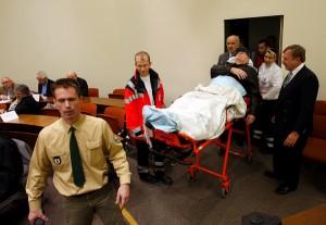 John Demjanjuk lying on a stretcher