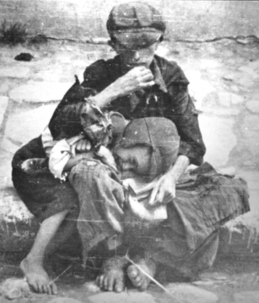 Starving children in the Warsaw Ghetto